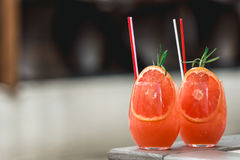 Refreshing orange coctail with grapefruit  on a table Stock Images