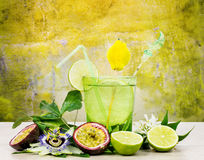 Refreshing passion fruit and lime cocktail Stock Photos