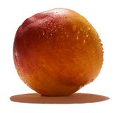 Refreshing Peach. A peach covered in water droplets isolated on a white background Stock Photography