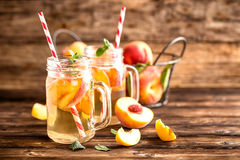 Refreshing peach drink Stock Photos