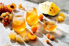 Free Refreshing Peach Ice Tea Or Lemonade In Glasses. Summer Yellow Fruit Cocktail. Hard Light Harsh Shadows. Stock Photography - 156017432