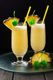 Refreshing pineapple cocktail with coconut cream Royalty Free Stock Photography