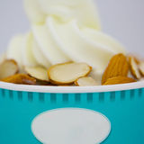 Refreshing Provocative tropical fruits nuts icecream. Refreshing Provocative tropical smoothie yogurt ice-cream with nuts Royalty Free Stock Images
