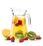 Refreshing punch. Pitcher with a refreshing fruit punch on a white background Stock Image