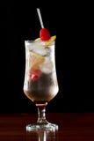 Refreshing raspberry lemonade. Raspberry lemonade served in a stemmed glass on a dark bar Royalty Free Stock Images