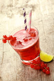 Refreshing redcurrant juice with fresh berries Stock Photo