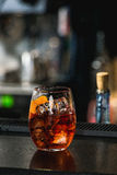 Refreshing ruby red cocktail with grape fruit isolated on a bar background Royalty Free Stock Photography