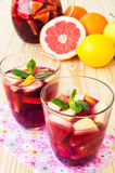 Refreshing sangria (punch) with fruits Stock Photography