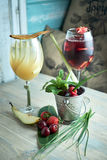 Refreshing sangria or punch with fruits in glass and pincher jpg Stock Photo
