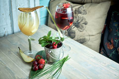 Refreshing sangria or punch with fruits in glass and pincher jpg Stock Photography