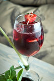 Refreshing sangria or punch with fruits in glass and pincher jpg Stock Photos