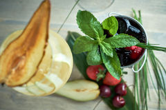 Refreshing sangria or punch with fruits in glass and pincher jpg Royalty Free Stock Images