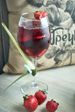 Refreshing sangria or punch with fruits in glass and pincher jpg Royalty Free Stock Photography