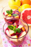 Refreshing sangria (punch) with fruits Stock Images