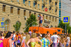 A refreshing shower. Festival participants refreshed under the pressure of water from a hose of special machines,Volgograd June 2015 Royalty Free Stock Photo