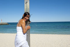 Refreshing shower for sexy woman at the ocean Stock Image