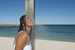 Refreshing shower for sexy woman at the ocean Stock Photography