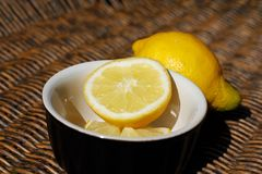 Refreshing Sliced Lemon Outdoors on Wooden Wicker Royalty Free Stock Photos