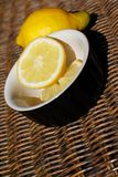 Refreshing Sliced Lemon Outdoors on Wooden Wicker Stock Photos