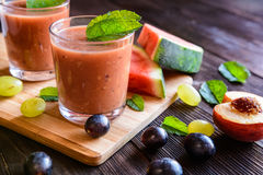 Refreshing smoothie with grape, watermelon and peach. Organic smoothie with grape, watermelon and peach in a glass jar Stock Images