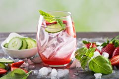 Refreshing spring or summer cocktails with strawberry and cucumber. Refreshing spring or summer cocktails with strawberry, basil and cucumber royalty free stock image