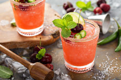 Refreshing summer cocktail with cherry. Refreshing summer cocktail with sweet cherry and ice Stock Photo