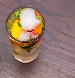 Refreshing summer cocktail with citrus, mint, alcohol and ice stock image