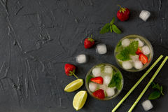Refreshing summer cocktail with lime, strawberry and mint. Mojit Royalty Free Stock Image