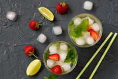 Refreshing summer cocktail with lime, strawberry and mint. Royalty Free Stock Photography