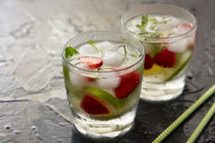 Refreshing summer cocktail with lime, strawberry and mint. Stock Photo