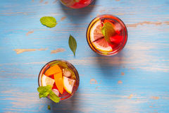 Refreshing summer cocktails. With citrus fruits over blue vintage background. Top view Stock Photos