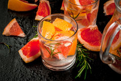 Refreshing summer detox cocktail of grapefruit and rosemary, wit Royalty Free Stock Images
