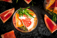 Refreshing summer detox cocktail of grapefruit and rosemary, wit Royalty Free Stock Photo