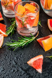 Refreshing summer detox cocktail of grapefruit and rosemary, wit Stock Images
