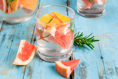 Refreshing summer detox cocktail of grapefruit and rosemary, on Royalty Free Stock Images