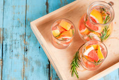 Refreshing summer detox cocktail of grapefruit and rosemary, on Stock Photo