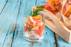 Refreshing summer detox cocktail of grapefruit and rosemary, on Stock Photography