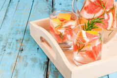 Refreshing summer detox cocktail of grapefruit and rosemary, on Royalty Free Stock Photo