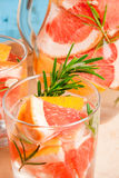 Refreshing summer detox cocktail of grapefruit and rosemary, on Stock Images
