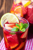 Refreshing summer drink with different fruits Stock Photos