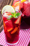 Refreshing summer drink with different fruits Stock Image