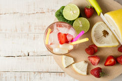 Refreshing summer drink with fruit and ice Stock Photos
