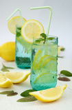 Refreshing summer drink with lemon, ice and mint Royalty Free Stock Photo