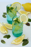Refreshing summer drink with lemon, ice and mint Royalty Free Stock Photos