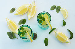 Refreshing summer drink with lemon, ice and mint Stock Images