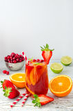 Refreshing summer drink sangria with fruits and berries stock images