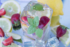 A refreshing summer drink of strawberries and lemon Royalty Free Stock Photo