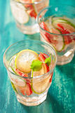 Refreshing summer drink with strawberry cucumber lime in glasses Stock Images