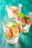 Refreshing summer drink with strawberry cucumber lime in glasses Royalty Free Stock Image