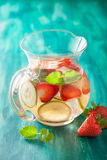 Refreshing summer drink with strawberry cucumber lime in jar Stock Image